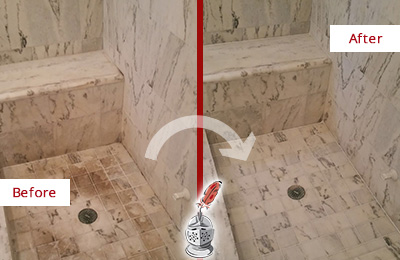 Before and After Picture of a Green Hills Marble Shower Honed to Remove Dark Stains
